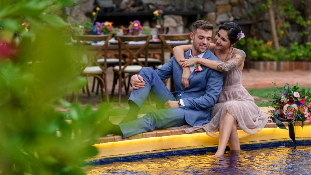 Happy couple at their pool view garden Wedding Reception